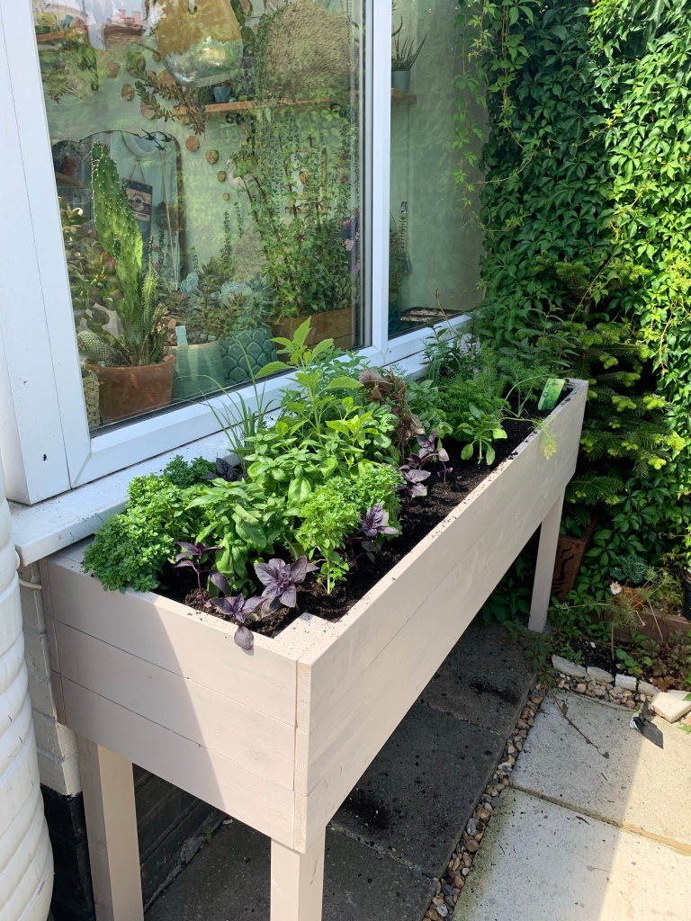 DIY herb planter painted with Cuprinol Gardnen Shades Muted Clay